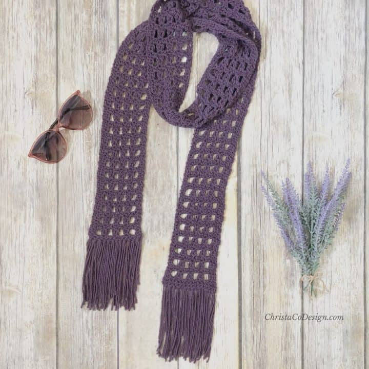 picture of lacy crochet summer scarf flat purple with sunglasses
