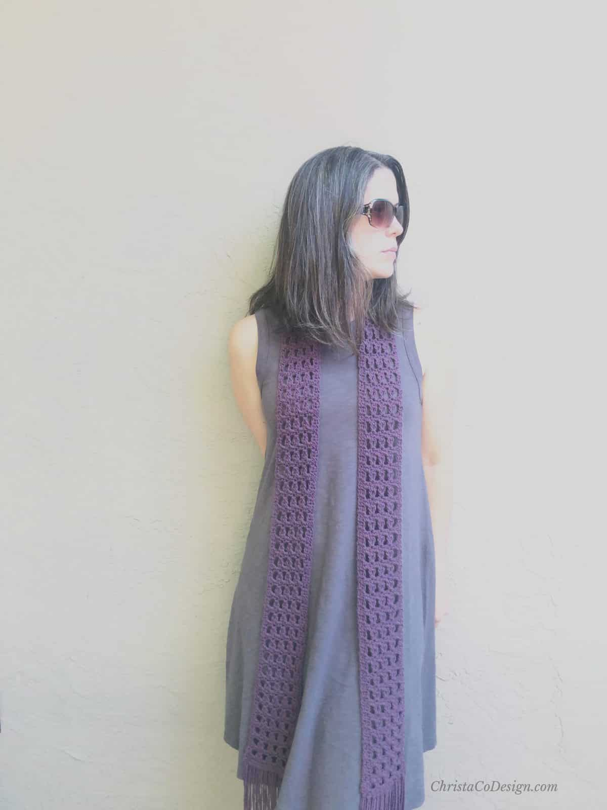 picture of woman in long lacy purple scarf