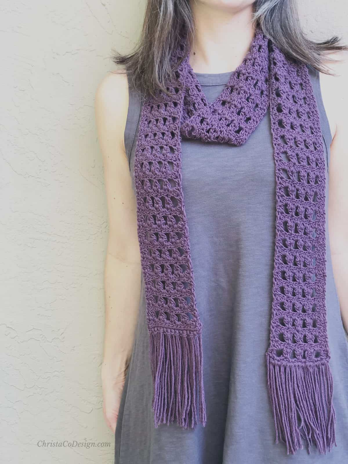 picture of lacy scarf looped with fringe in purple