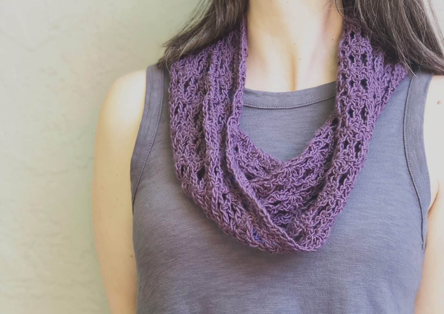 picture of purple easy crochet lace cowl on woman in grey