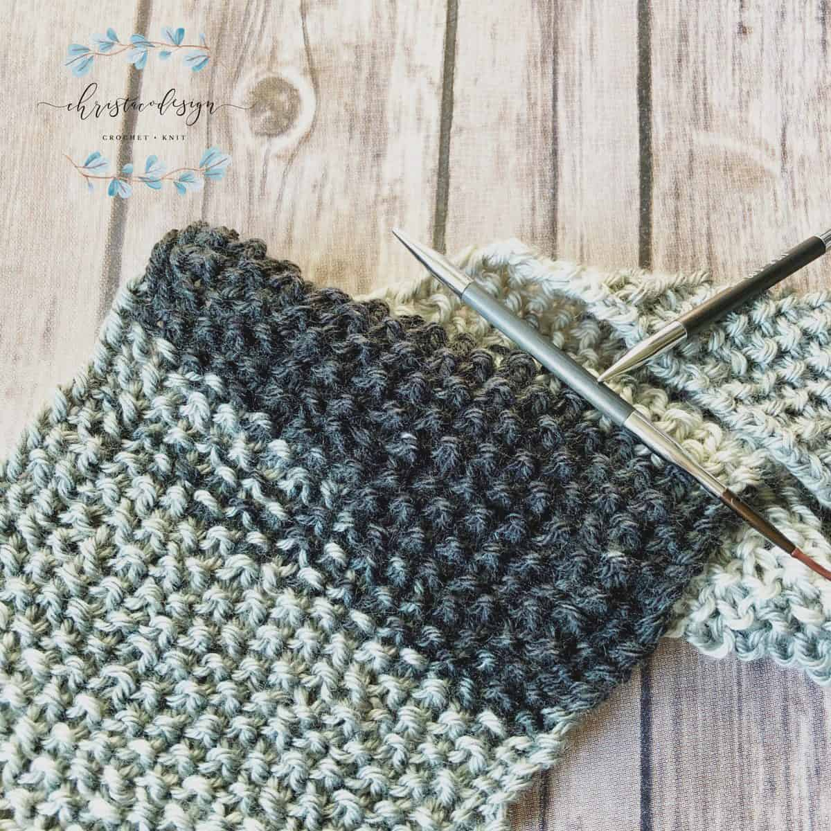 picture of textured knit scarf on knitting needles