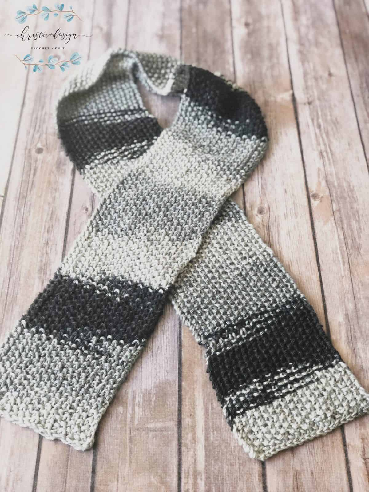 picture of skinny grey textured knit scarf crossed flat