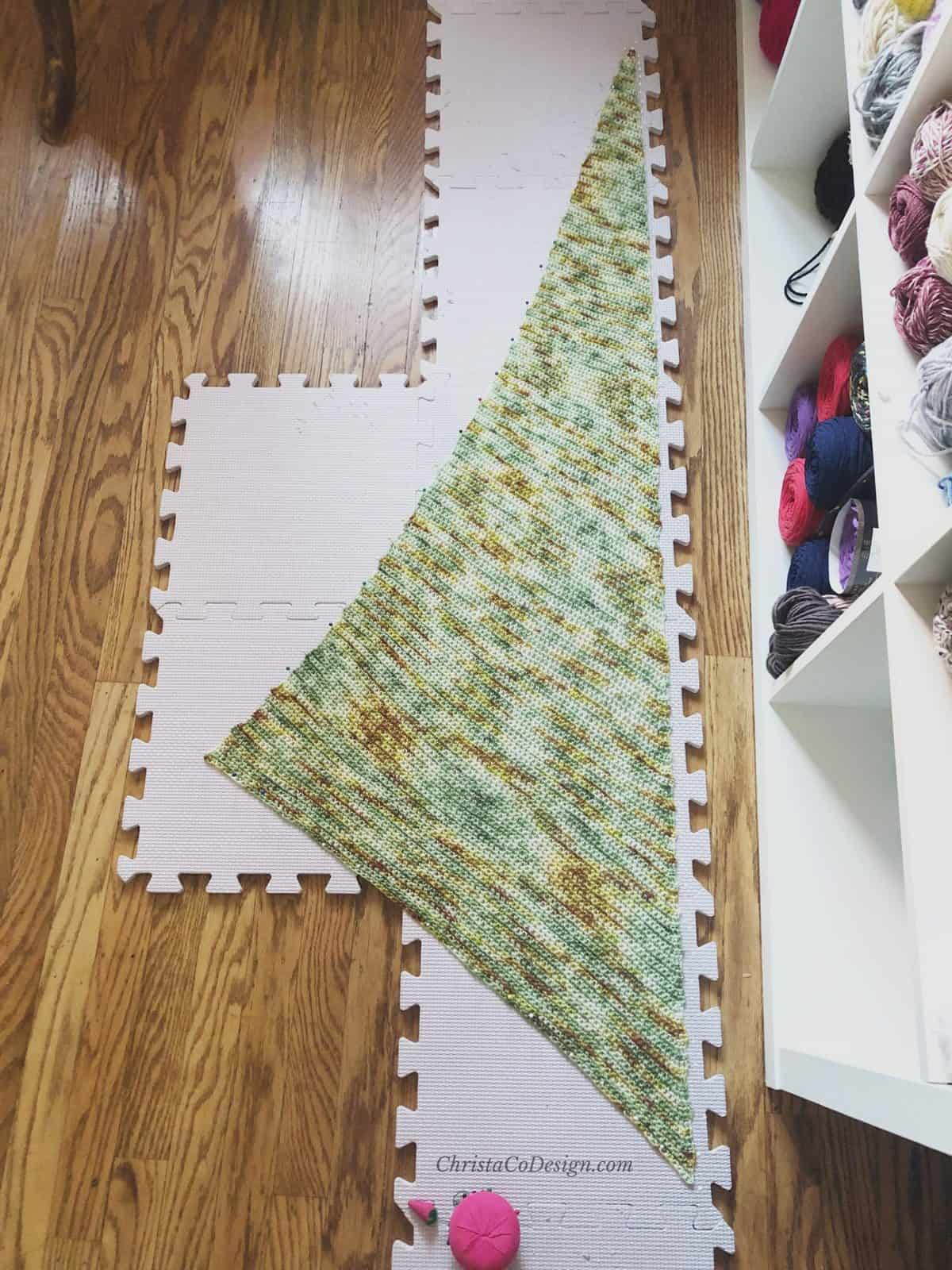 Picture of triangle scarf on blocking boards