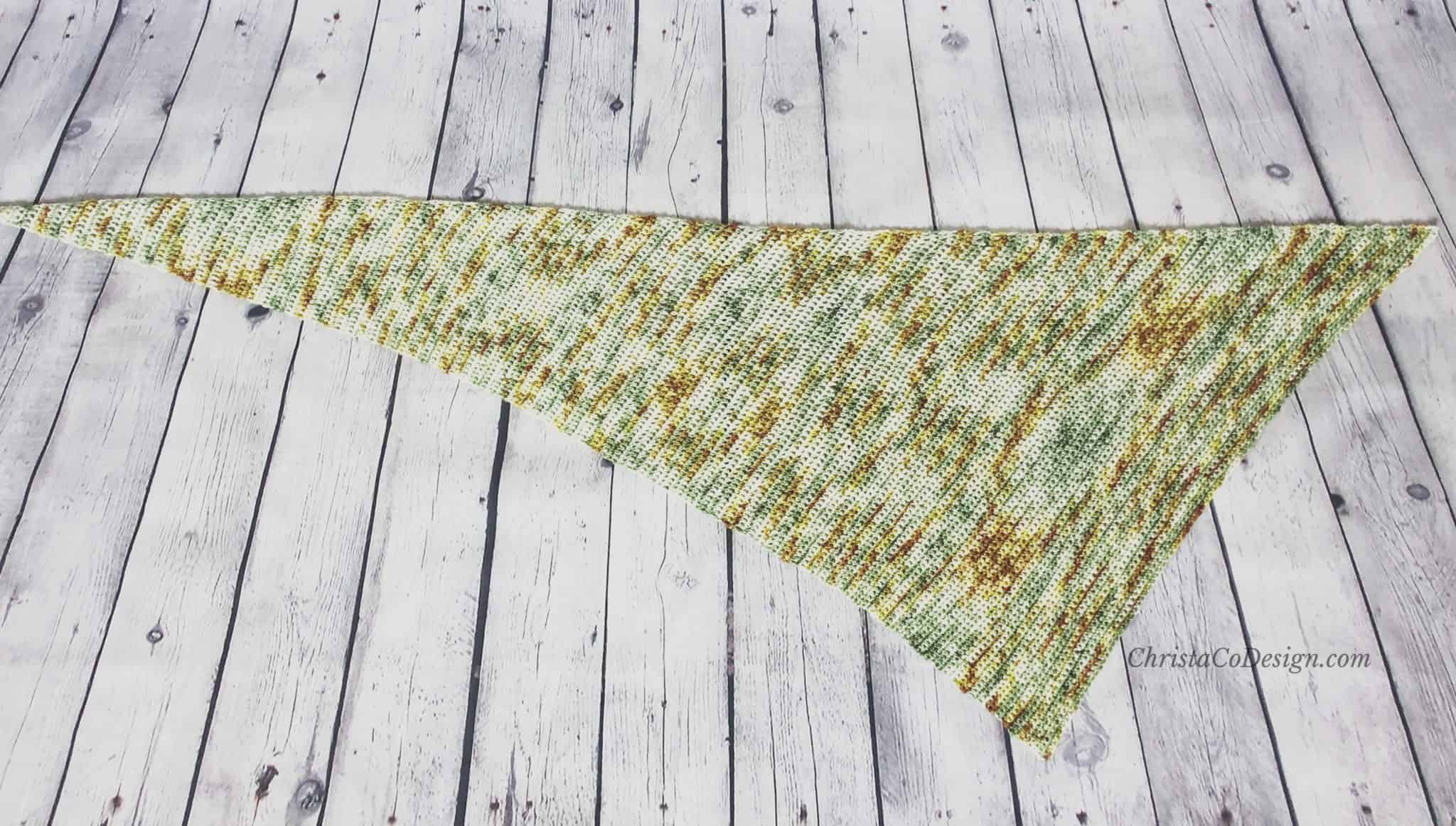 Picture of asymmetrical triangle scarf laid flat