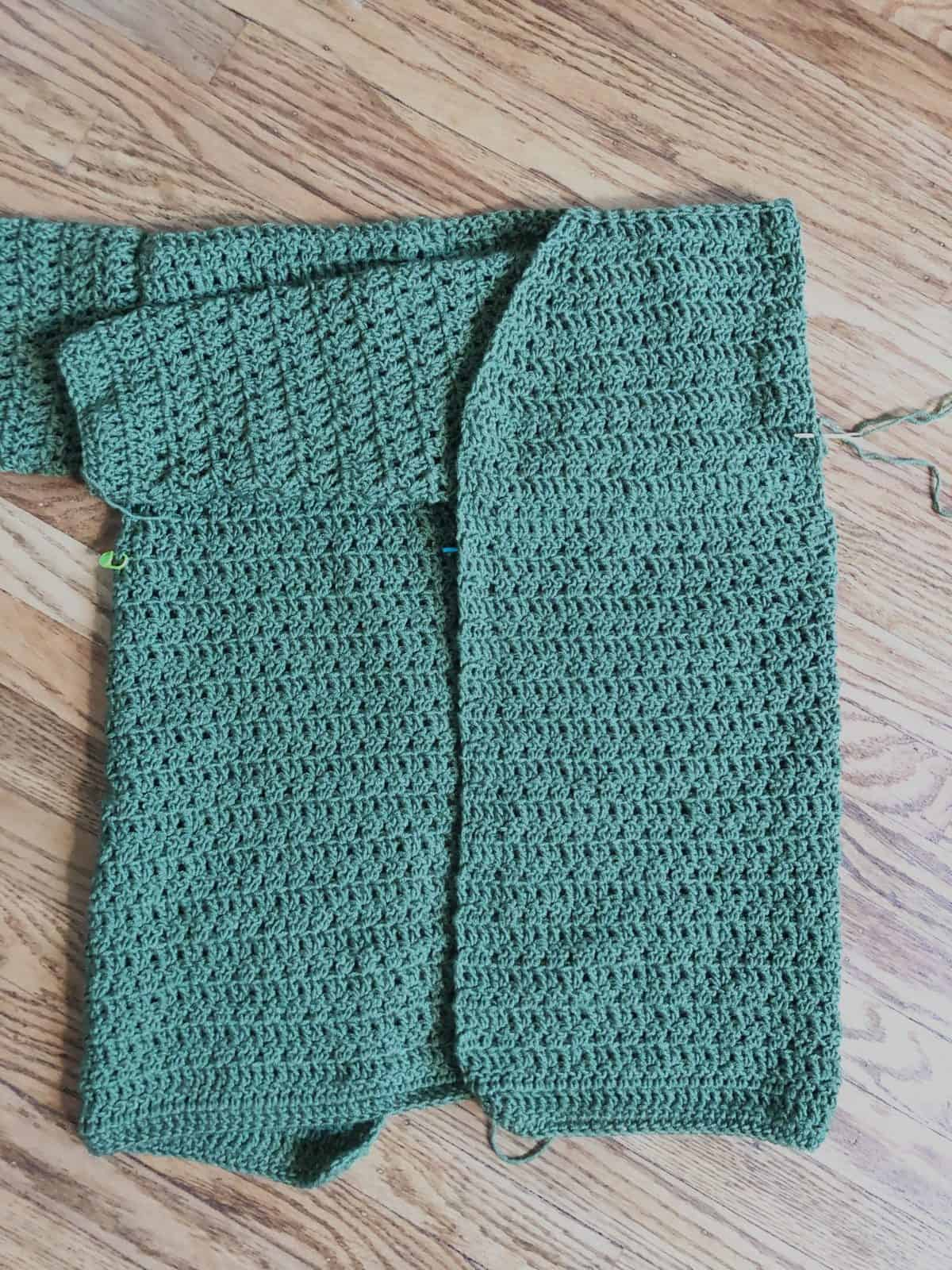 Cardigan wrong side out with sleeve right side out.