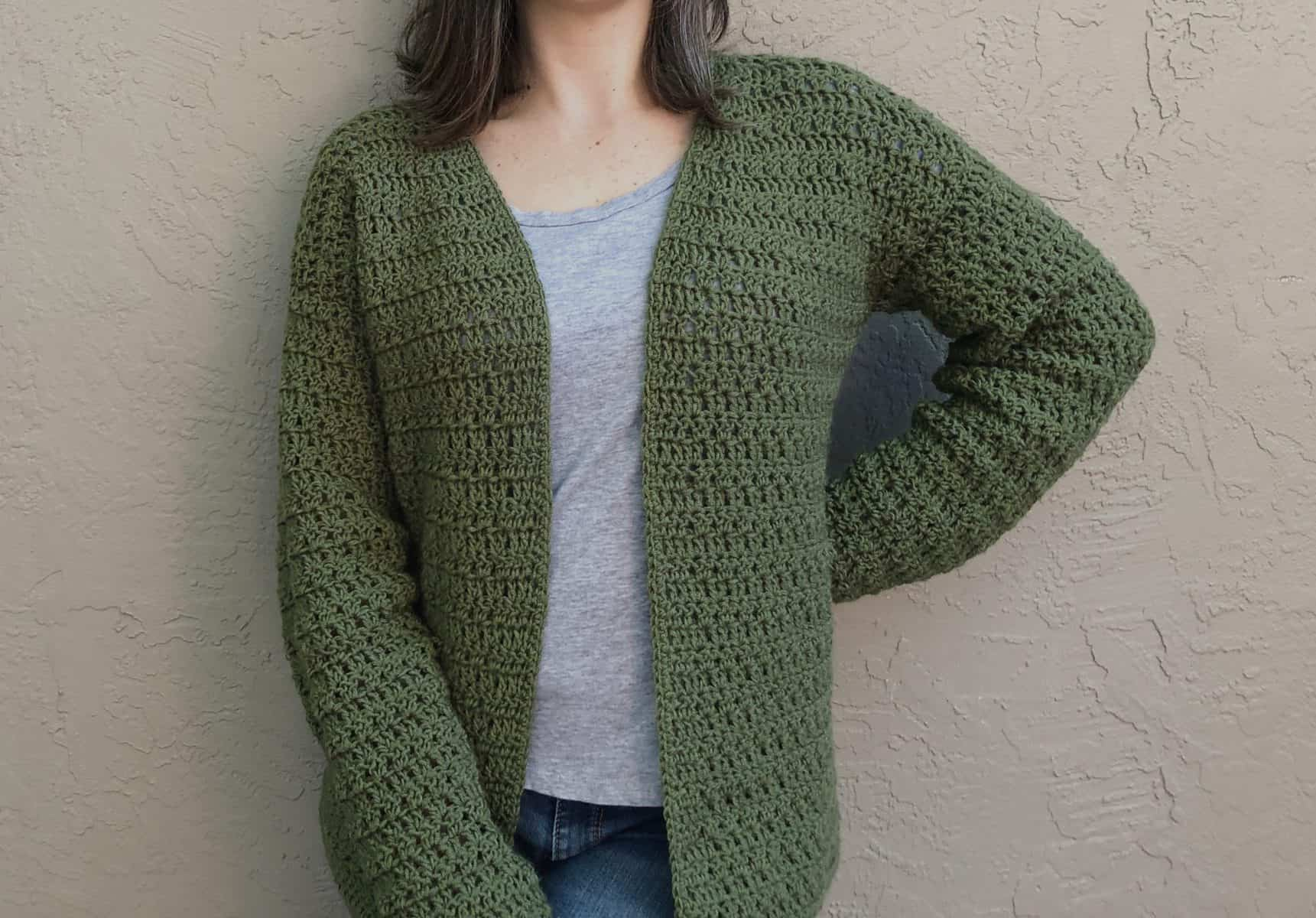 Picture of woman  wearing open front crochet cardigan green
