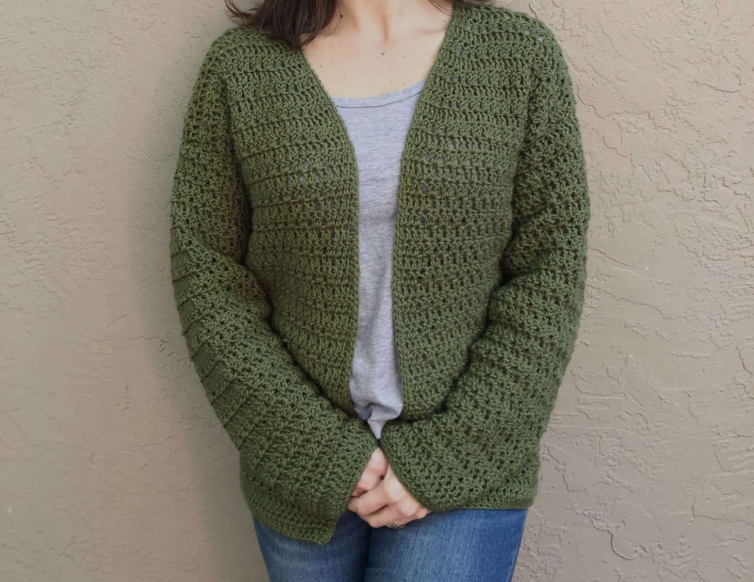 Long sleeve crochet cardigan with minimal seaming.