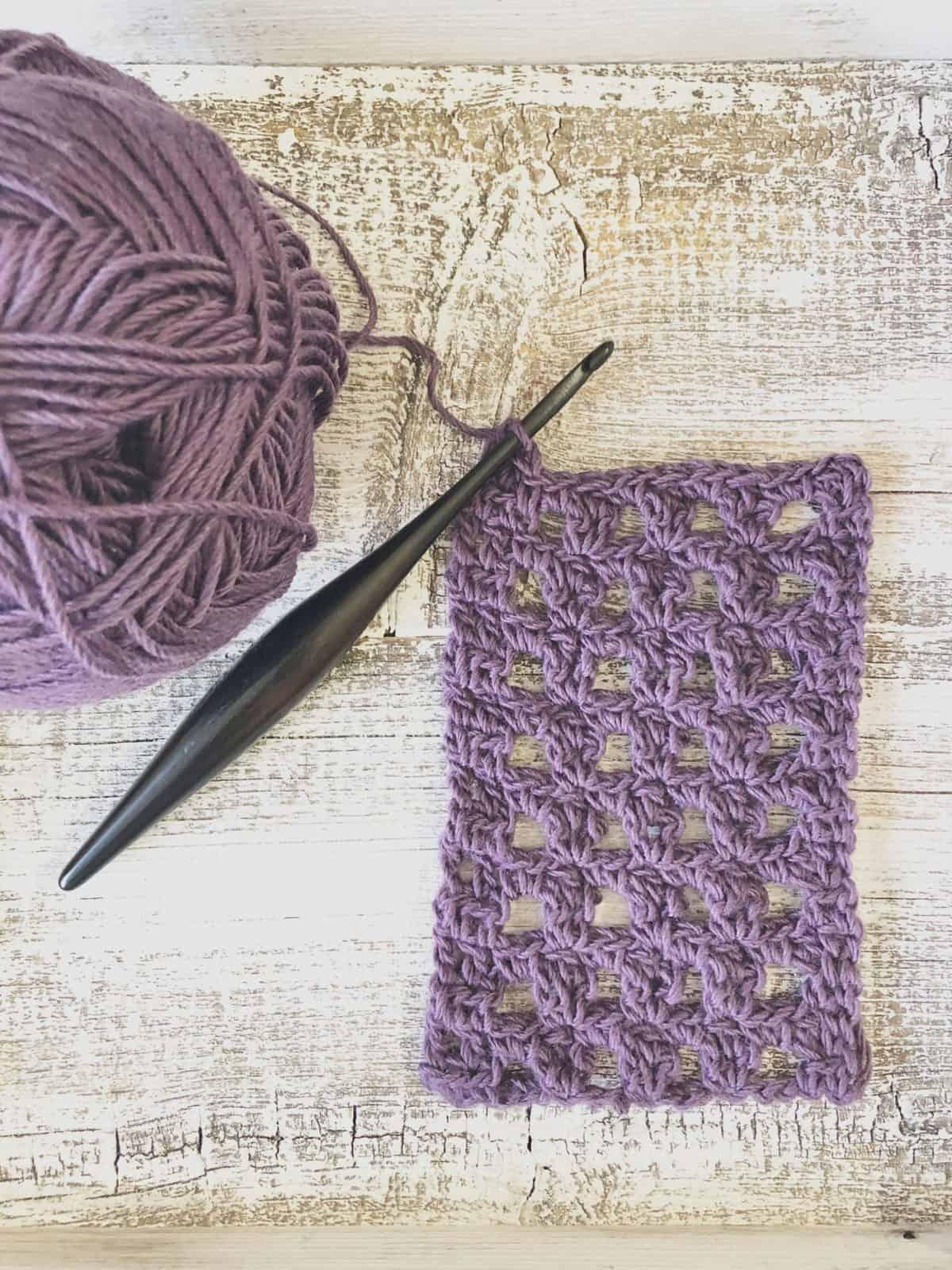 picture of progress of Berryessa crochet scarf lace in purple