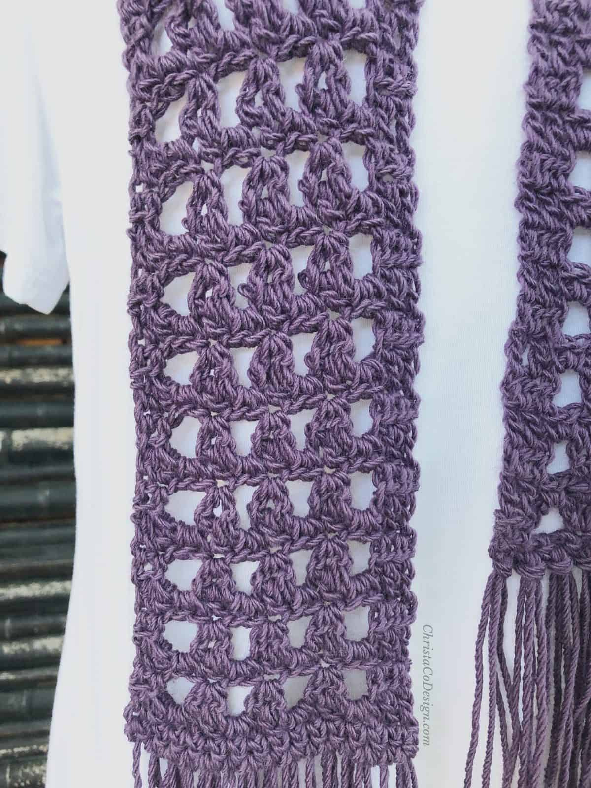 picture of purple crochet lace scarf on white