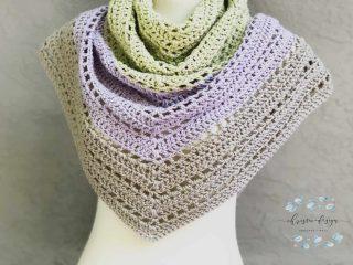 Beige, purple, green crochet triangle shawl.