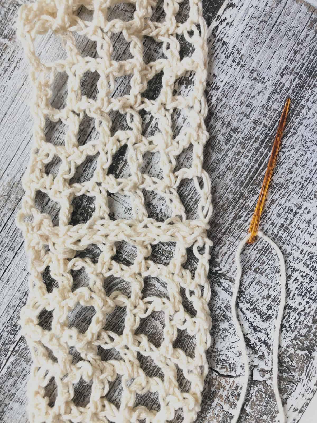 Infinity cowl seam with yarn needle.