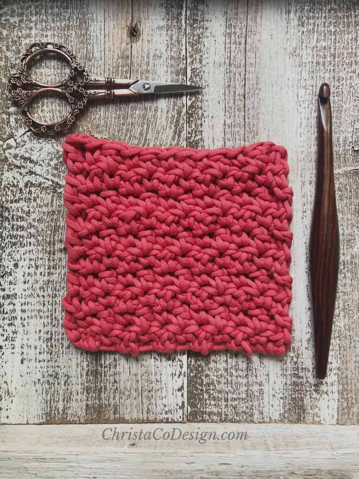 Scissors, swatch in red and hook.