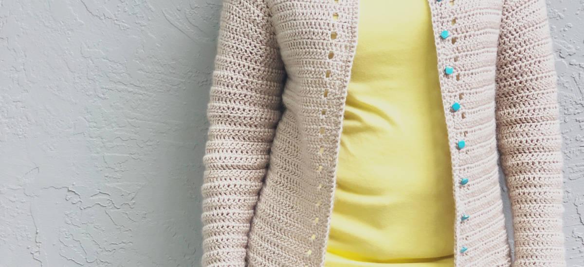 Close up of eyelet detail on crochet cardigan.