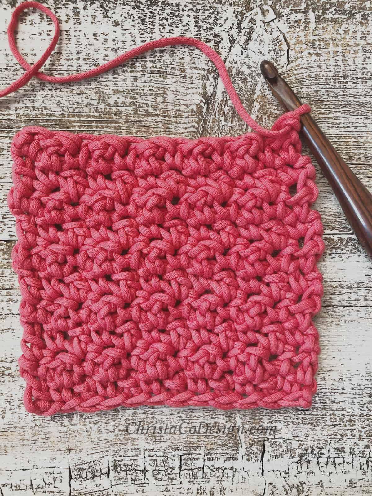 picture of red lemon peel square on hook lemon peel stitch tutorial