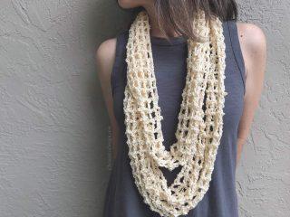 Woman wearing cream lace crochet infinity cowl.
