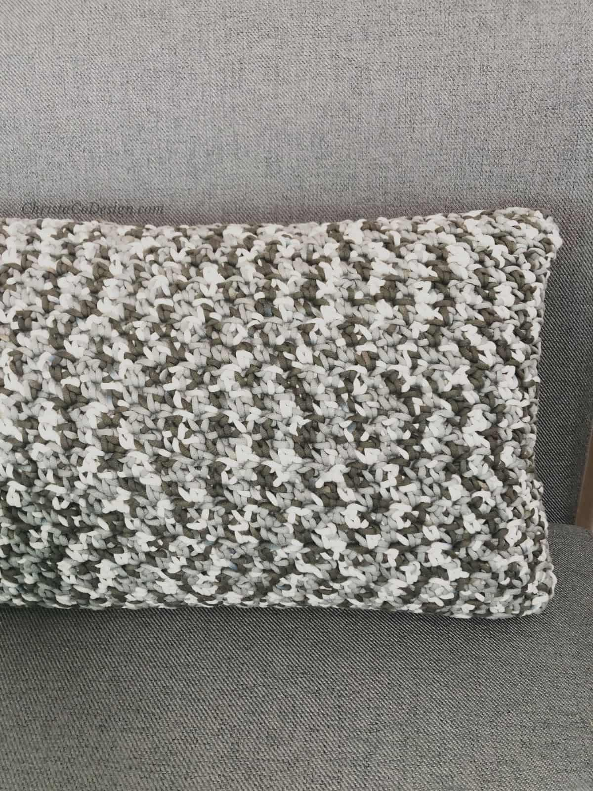 picture of speckled grey free crochet pillow pattern on chair