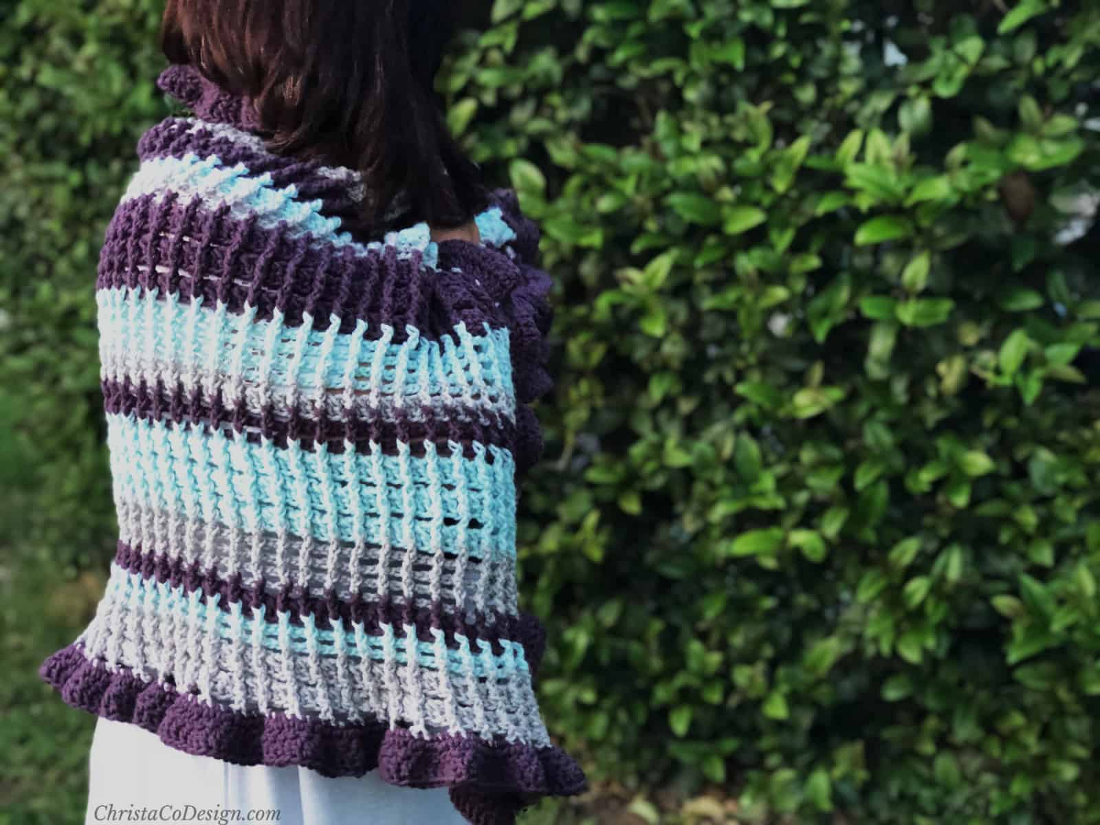 picture of woman wrapped in striped ruffle edge wrap