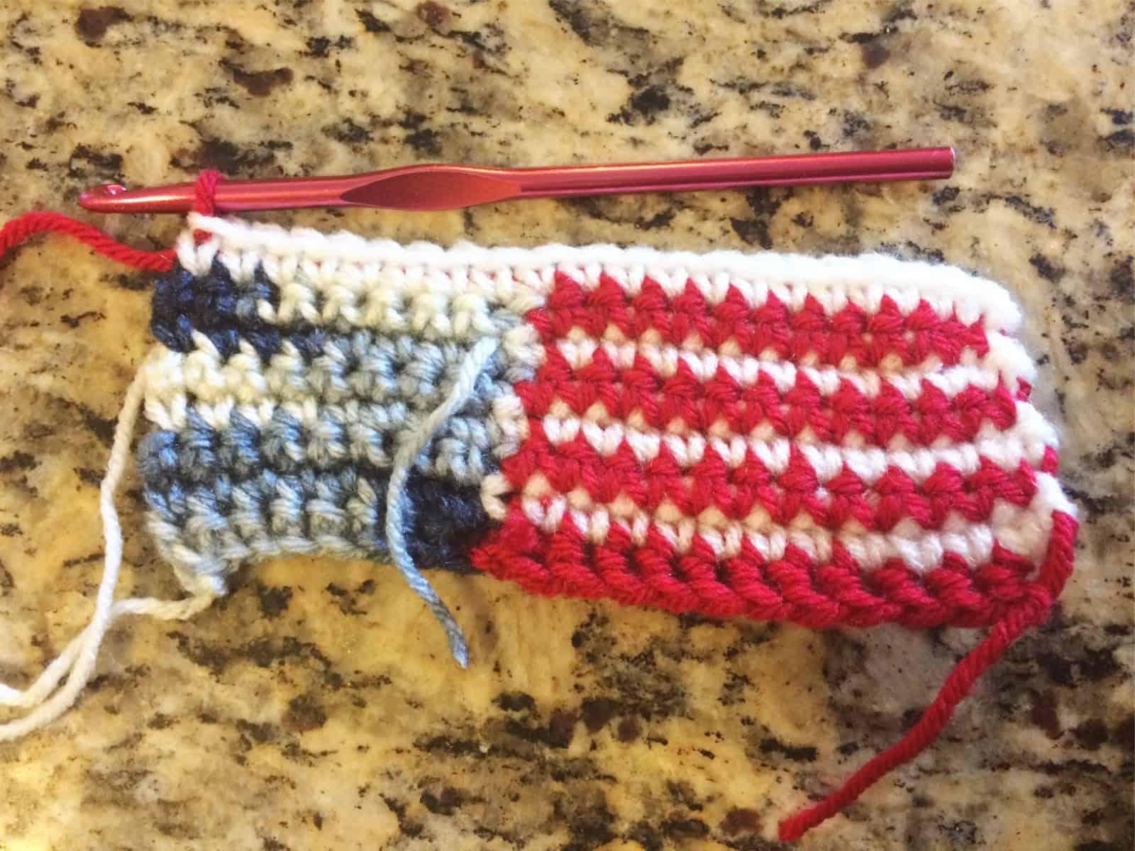 Crochet us flag through row 7.