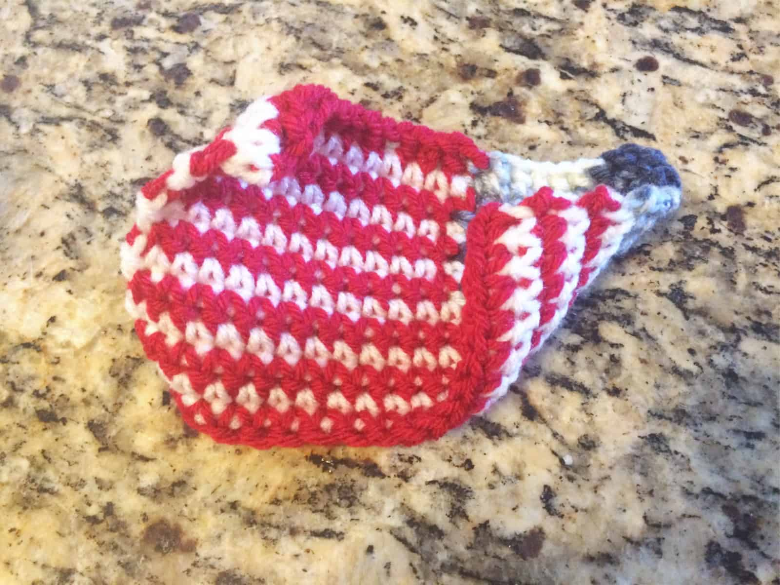 picture of crochet flag curled before blocking