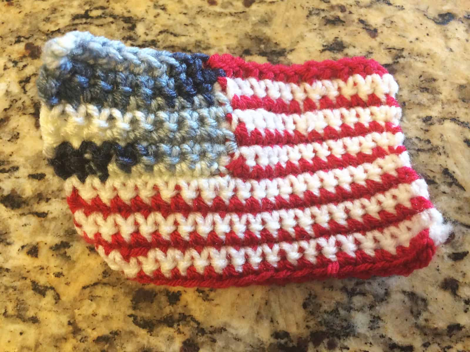 Finished crochet flag curled edges.
