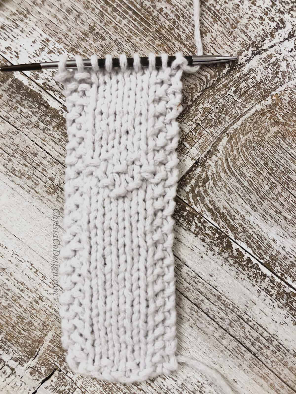 picture of full white bookmark on needles
