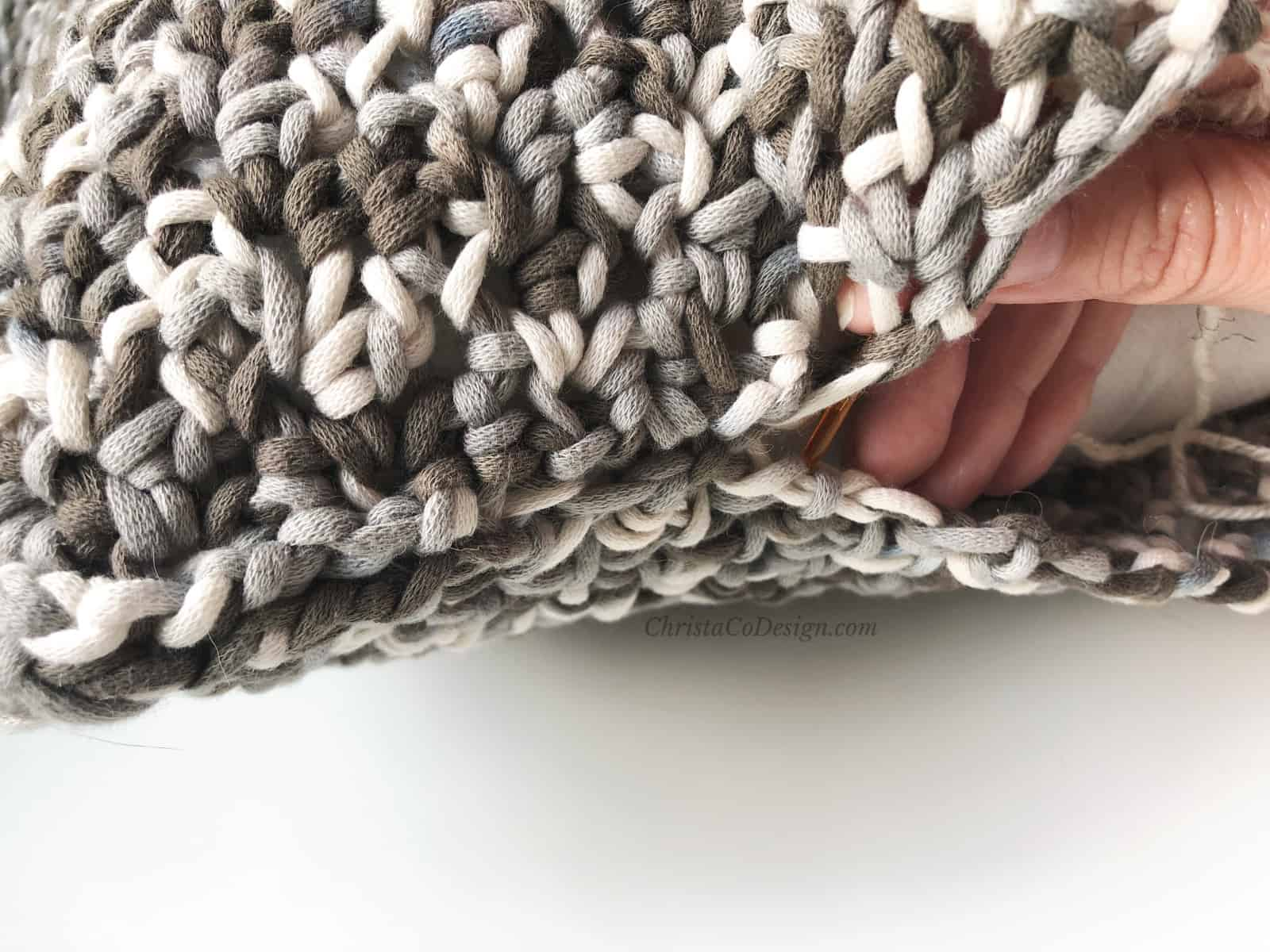 picture of hand in pillow seam