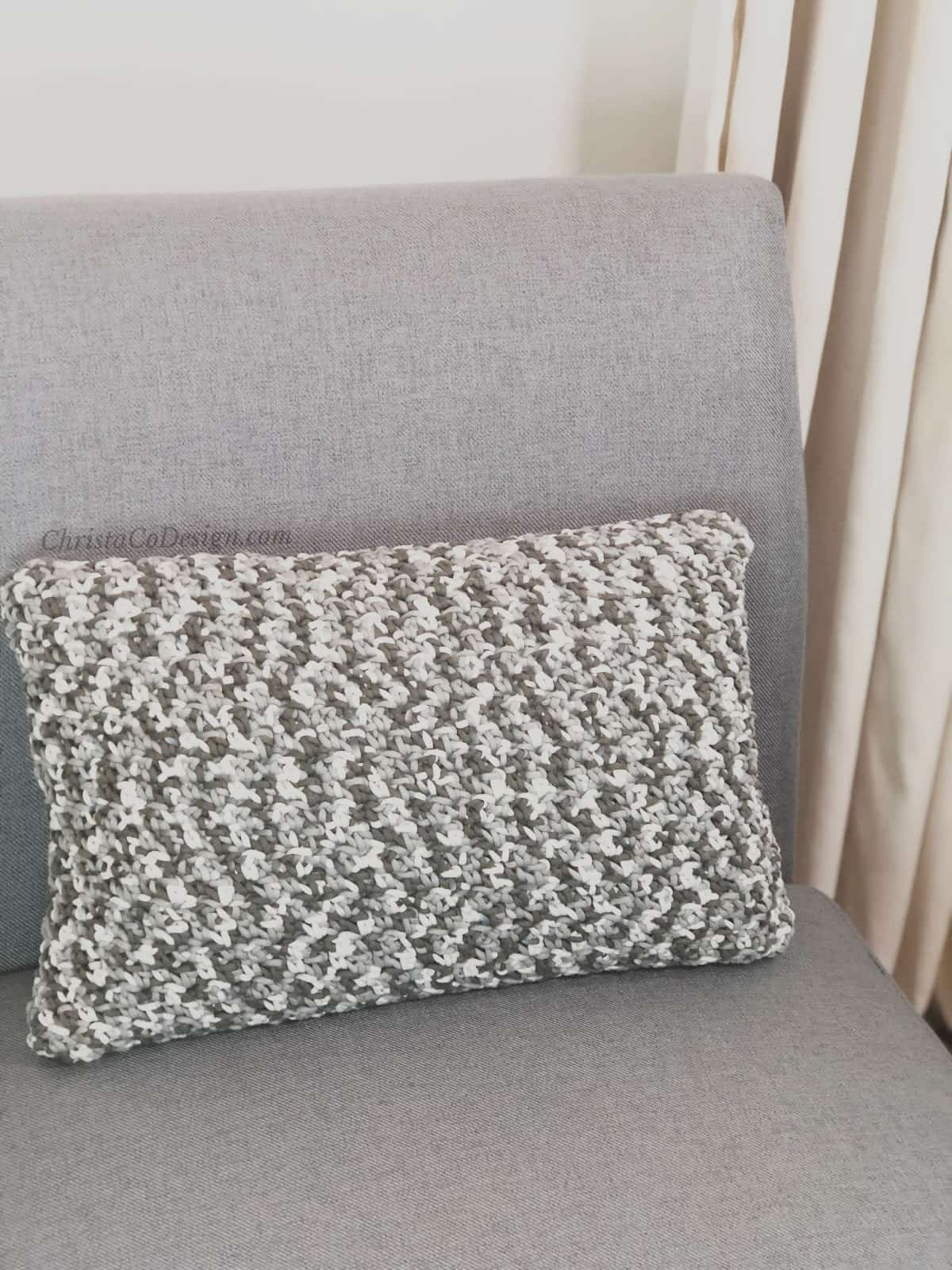 picture of free crochet pillow pattern on grey chair
