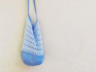 picture of blue crochet shoulder bag hanging