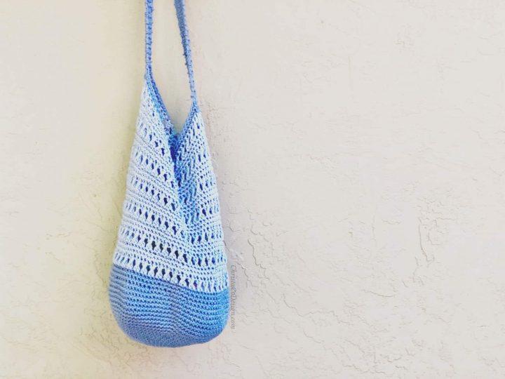 picture of blue crochet shoulder bag hanging