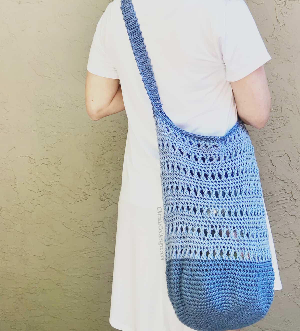 picture of blue crochet shoulder bag over shoulder
