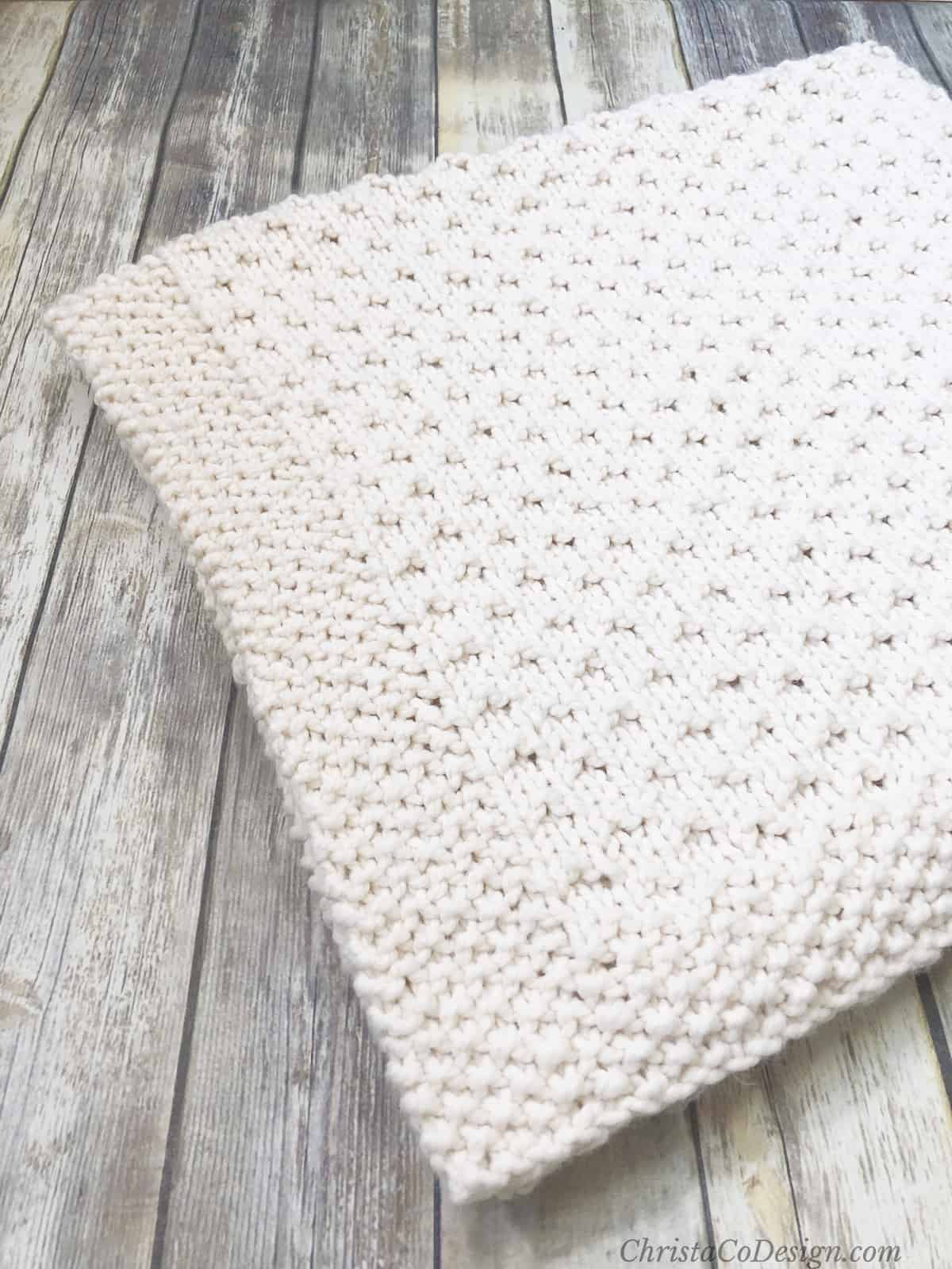 picture of folded cream Bella vita knit blanket