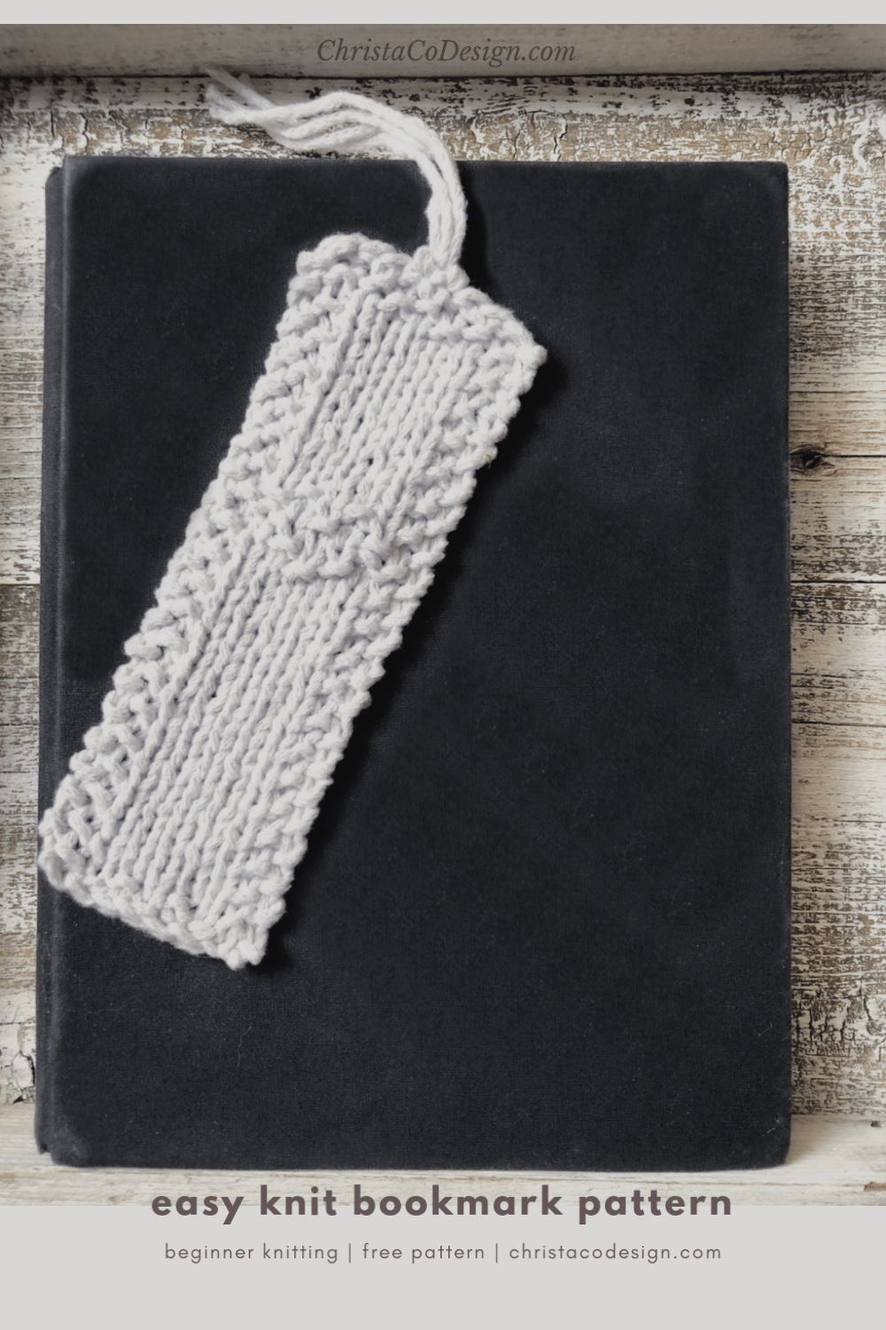 picture with text of white knitted bookmark on black book