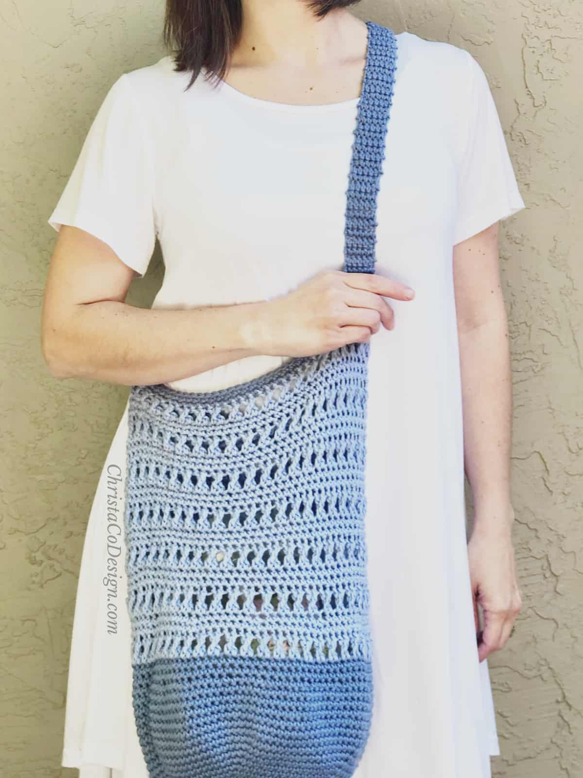 picture of woman with blue crochet shoulder bag on