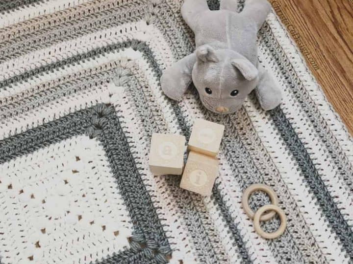picture of striped grey white crochet puff stitch blanket