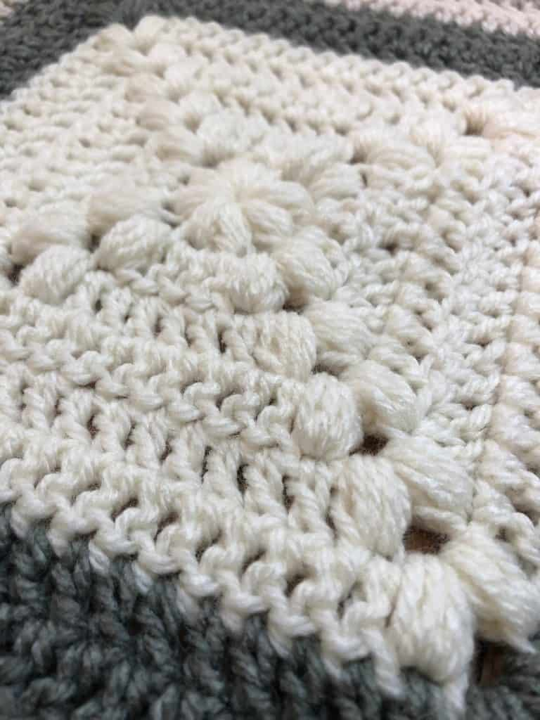 Center out puff stitch blanket square pattern.
