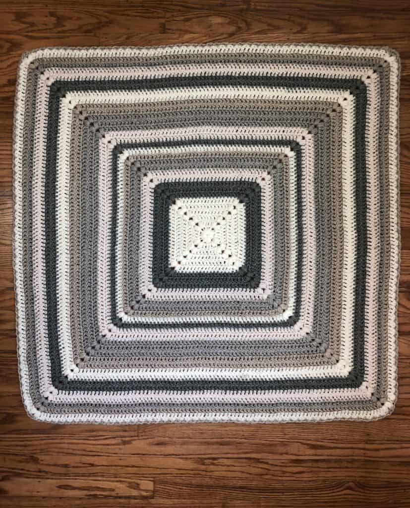 Striped blanket in square laid flat.