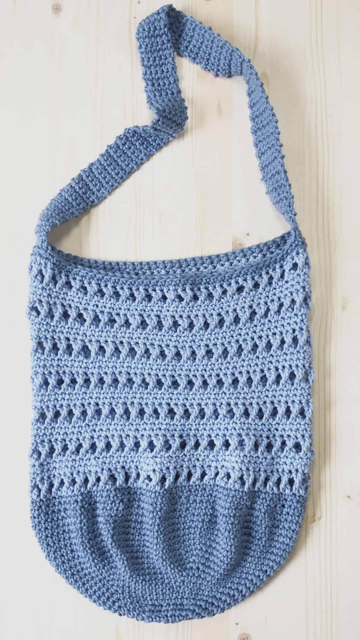 picture of blue crochet shoulder bag laid flat