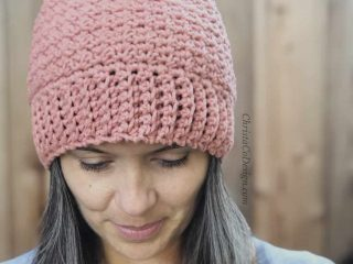 picture of pink bottom up hat crochet Positano pattern woman looking down