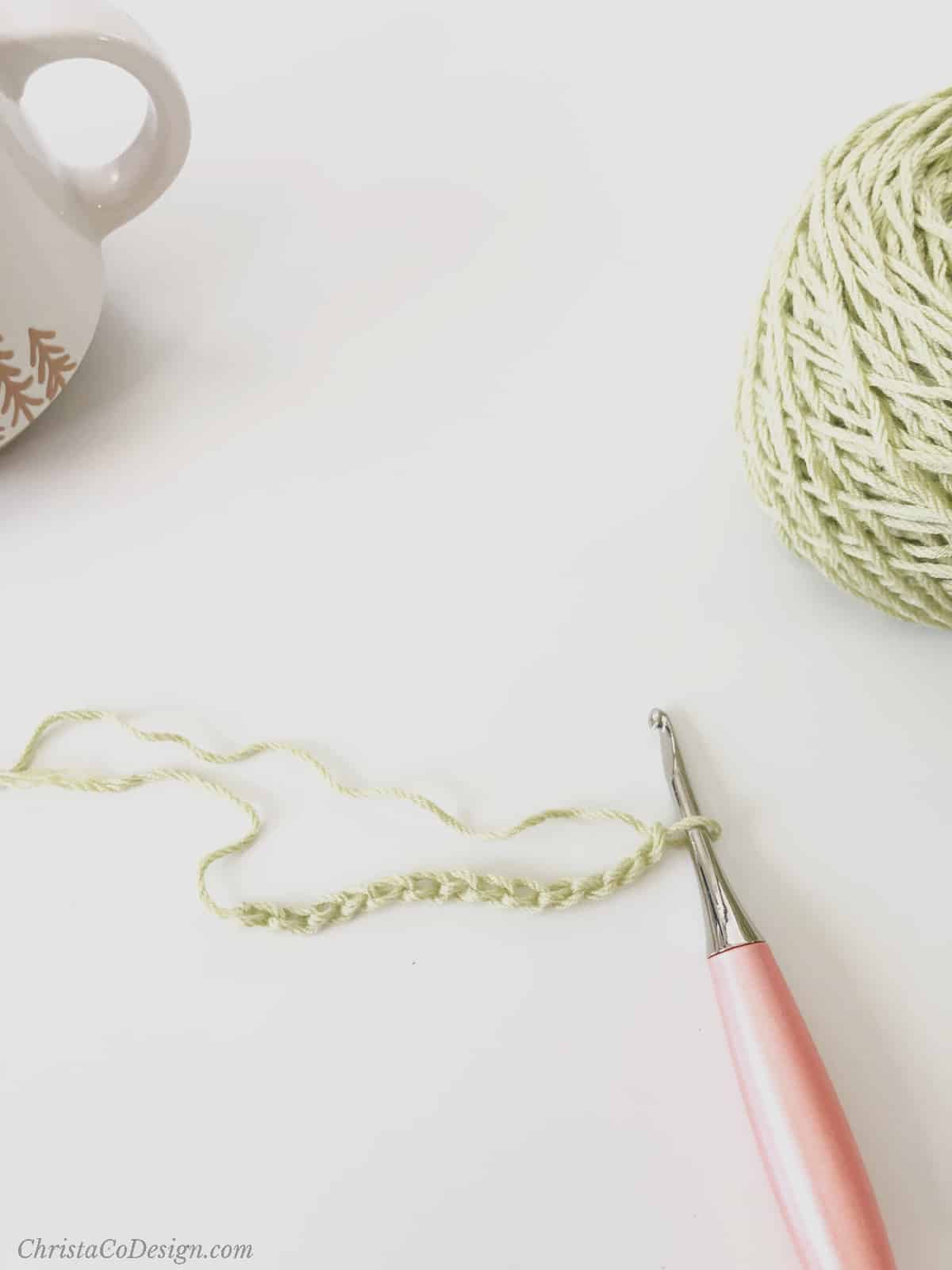 picture of green crochet chain on peach hook
