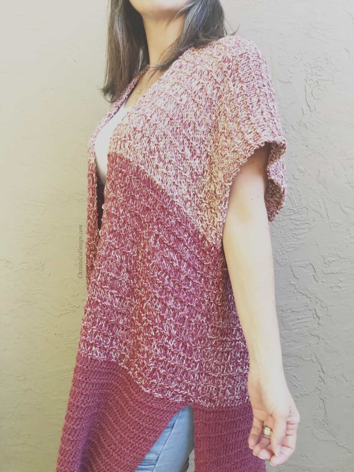 picture of woman in striped maroon ombre loose simple knit cardigan