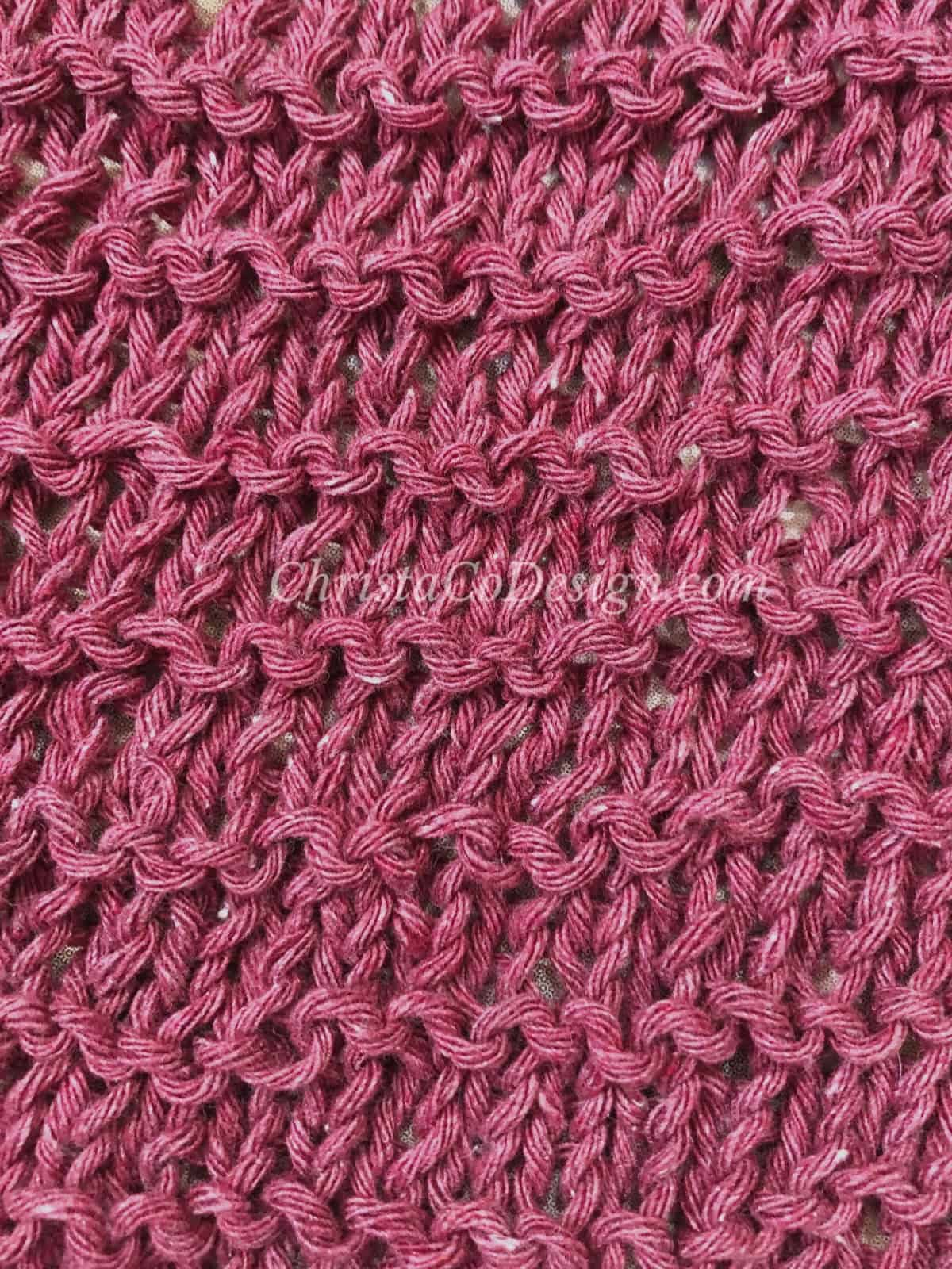 picture of knit stitches close up in maroon