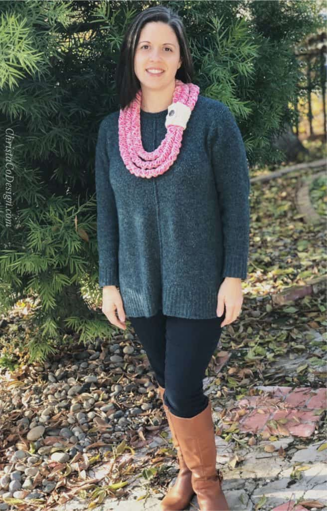picture of woman in blue sweater with chunky crochet necklace bright pink