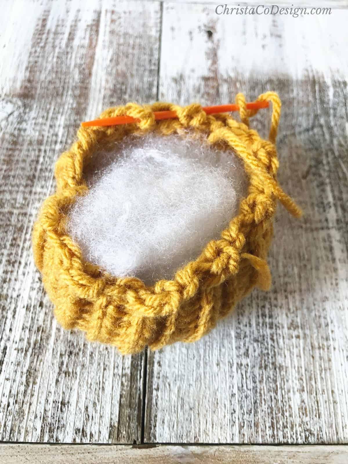 picture of seaming stuffed pumpkin crochet