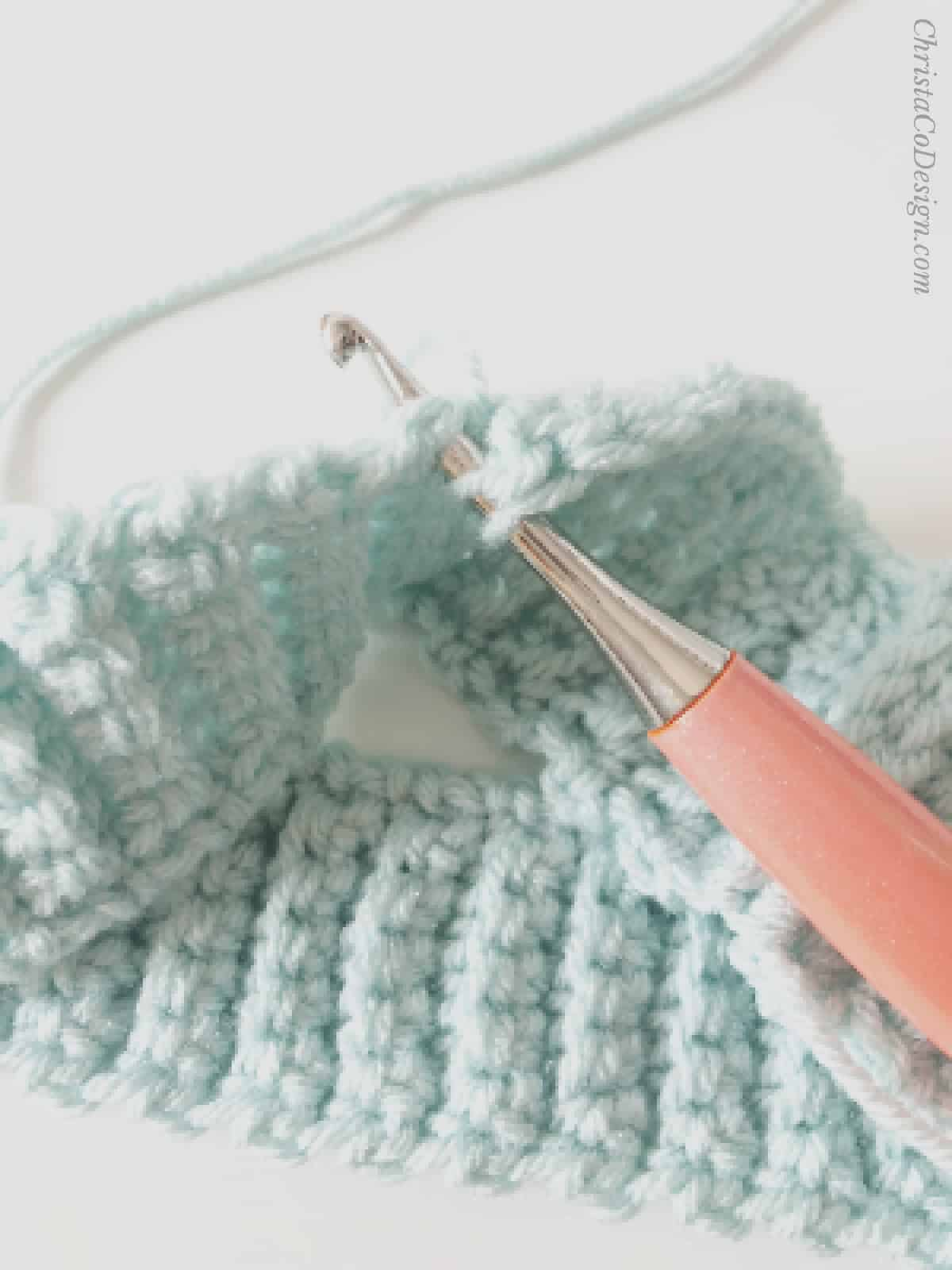 picture of how to insert hook into sides of crochet ribbing