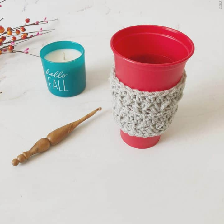 picture of crochet coffee to go cup sleeve grey on red