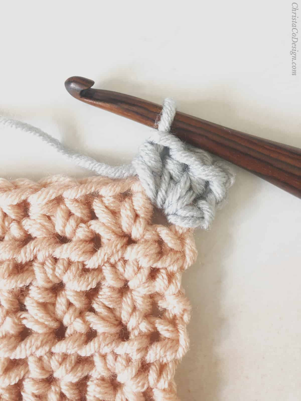 picture of corner stitches crochet border on blanket