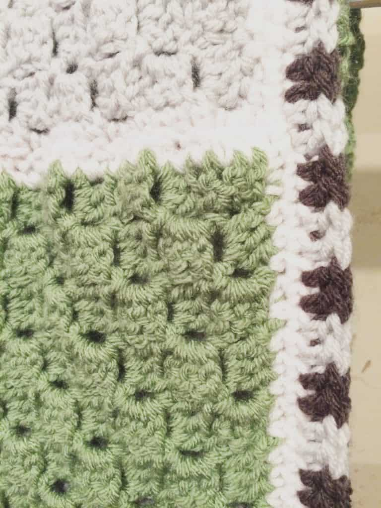 picture of grey and green crochet blanket c2c border color changing tips