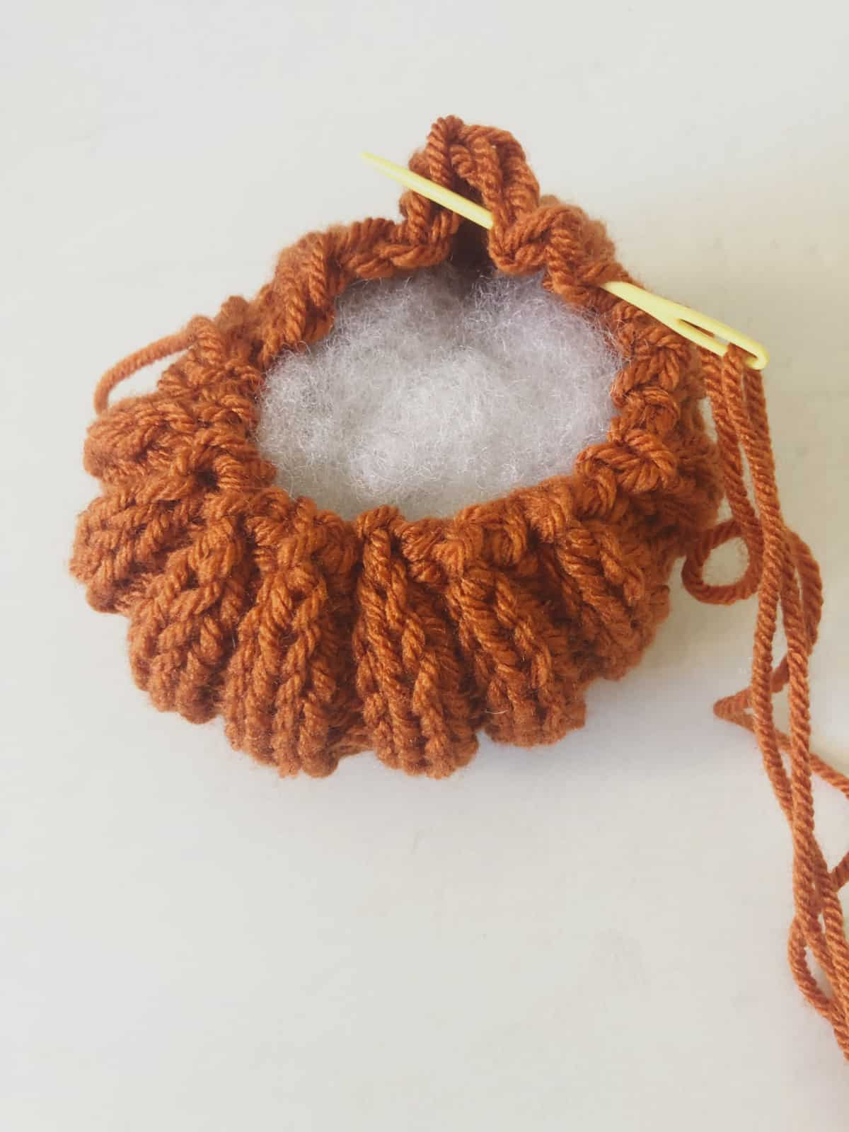 picture of sewing top of pumpkin closed running stitch