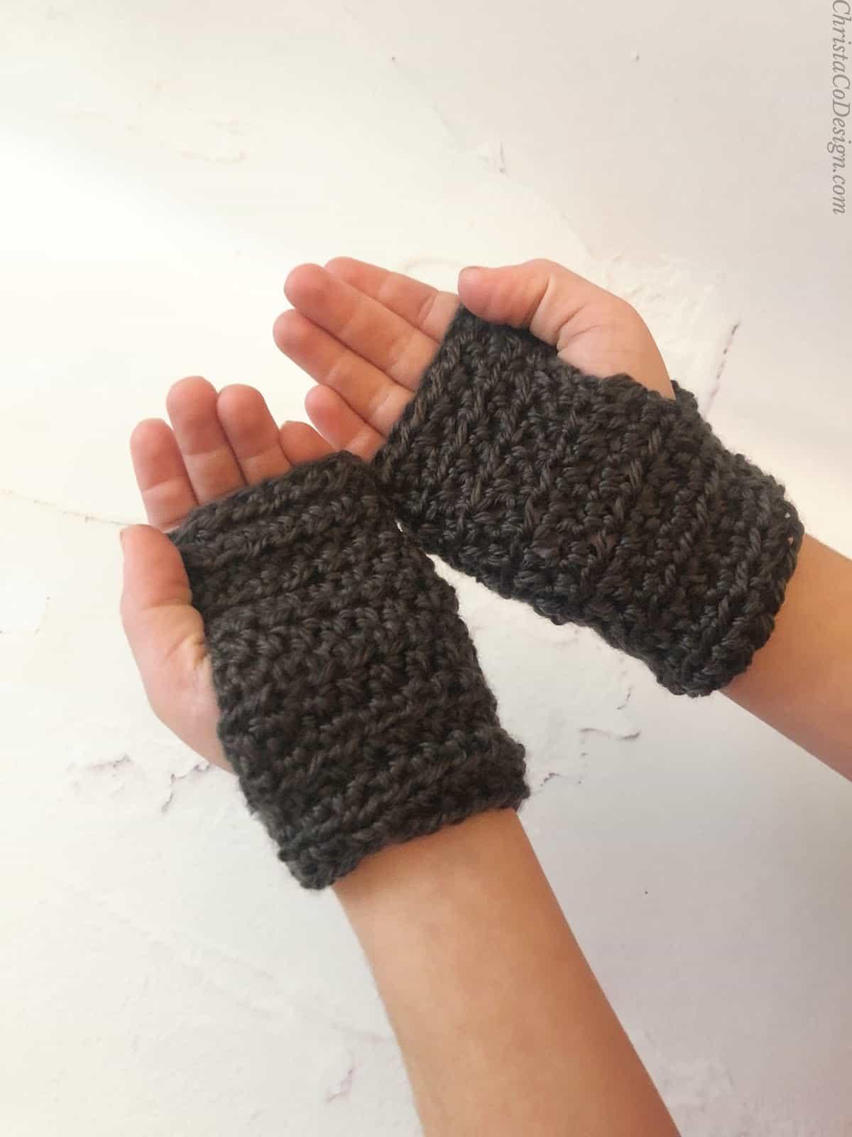 picture of crochet fingerless gloves on boys hands