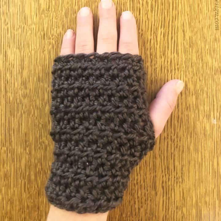 picture of modeled kids wrist warmers crochet pattern